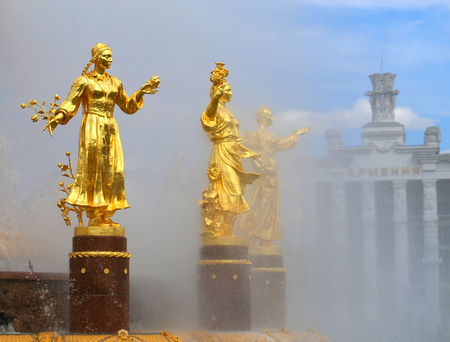 Miracle Wonderful photo of the Golden Fountain Friendship of Peoples on a background of blue sky with clouds in Moscow