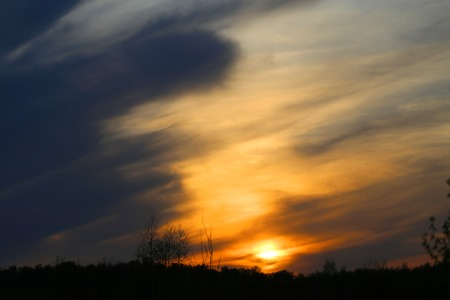 Spring evening sunset photo with clouds and clouds last rays Stock fotó