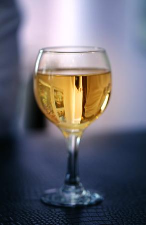 Fine photo bright white tasty wine in a transparent glass at restaurant Stok Fotoğraf - 124102031