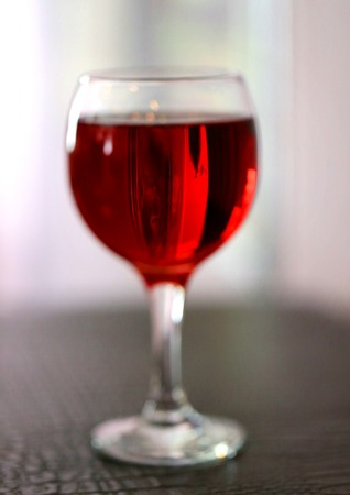 Fine photo bright red tasty wine in a transparent glass at restaurant