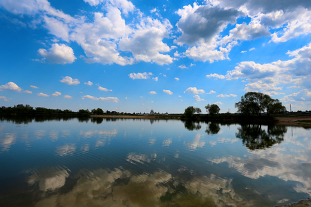 Beautiful photo of spring landscape with lake and sky. Reflections in the water. 写真素材