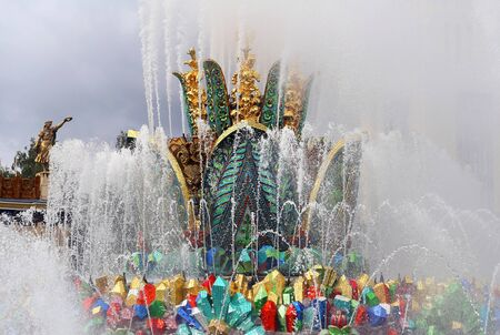 Beautiful photo of the golden fountain Stone Flower in Moscow in the park on a sunny day.