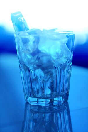 Macro photo of blue coarse ice in a transparent glass in a cafe 스톡 콘텐츠