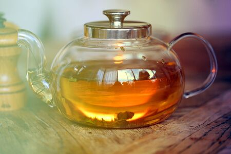Tasty bright herbal tea close-up in a restaurant in a transparent bowl. Imagens