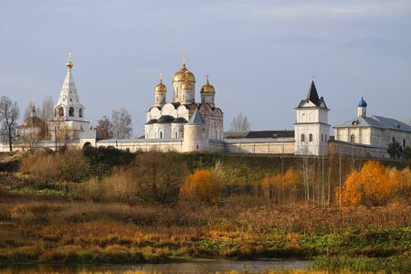 Beautiful autumn photo of an Orthodox monastery on the river Bank in Mozhaisk