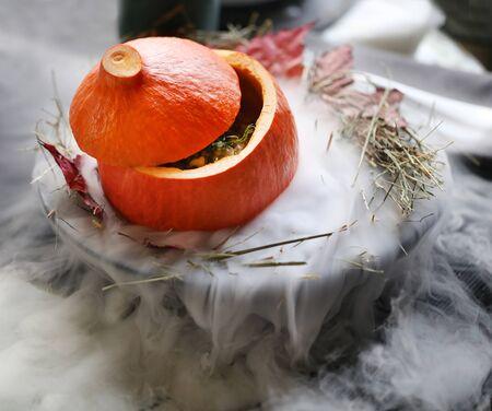 Photo macro of a large red pumpkin on nitrogen in a restaurant Banco de Imagens
