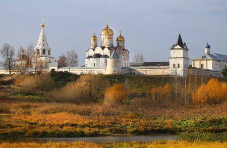 Photo of an ancient Christian monastery with Golden domes in the Russian city