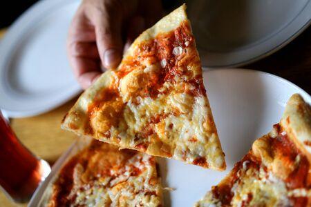 Photo macro of a tasty slice of pizza in a restaurant Zdjęcie Seryjne
