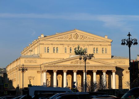Beautiful photo of the Bolshoi Theater in Moscow with a monument on the square on a sunny day