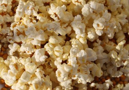 Photo background of salty popcorn illuminated by the sun
