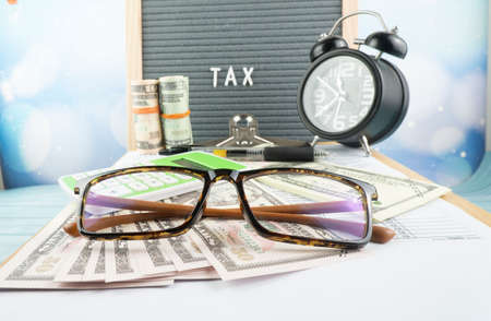 Tax-filling concept featuring half of U.S IRS 1040 form.