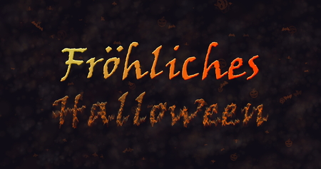 dissolving: Frohliches Halloween text in German dissolving into dust to bottom  Stock Photo