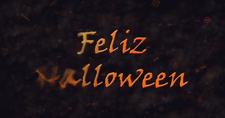 dissolving: Feliz Halloween text in Spanish dissolving into dust to left  Stock Photo