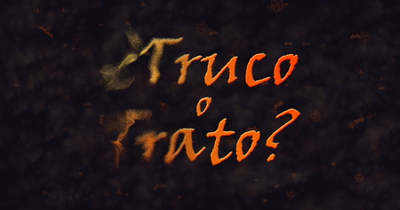 dissolving: Truco o Trato (Trick or Treat) Spanish text dissolving into dust from left