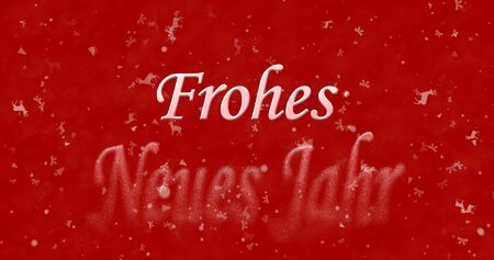 turns of the year: Happy New Year text in German Frohes neues Jahr turns to dust from bottom on red background