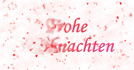Merry Christmas text in German Frohe Weihnachten turns to dust from left on white background Stock Photo