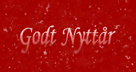 turns of the year: Happy New Year text in Norwegian Godt nyttar turns to dust from bottom on red background