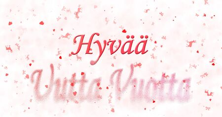 turns of the year: Happy New Year text in Finnish Hyvaa uutta vuotta turns to dust from bottom on white background