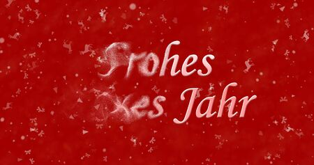 turns of the year: Happy New Year text in German Frohes neues Jahr turns to dust from left on red background Stock Photo