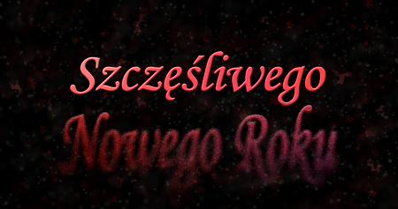 turns of the year: Happy New Year text in Polish Szczesliwego Nowego Roku turns to dust from bottom on black background Stock Photo