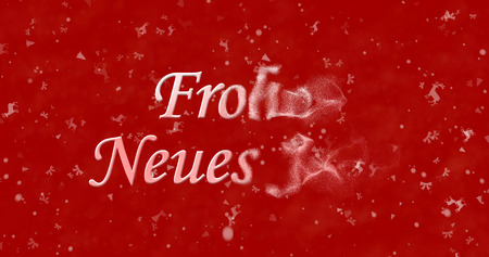 turns of the year: Happy New Year text in German Frohes neues Jahr turns to dust from right on red background Stock Photo