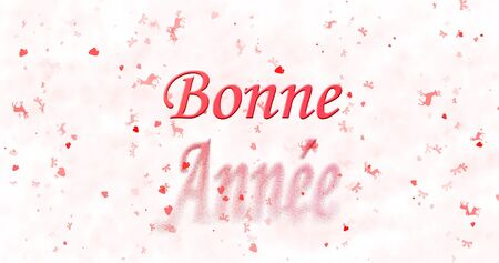 turns of the year: Happy New Year text in French Bonne annee turns to dust from bottom on white background