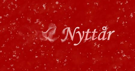 turns of the year: Happy New Year text in Norwegian Godt nyttar turns to dust from left on red background Stock Photo
