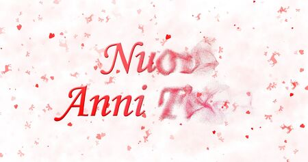 turns of the year: Happy New Year text in Italian Nuovi anni felici turns to dust from right on white background