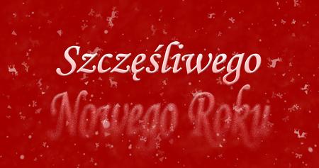 turns of the year: Happy New Year text in Polish Szczesliwego Nowego Roku turns to dust from bottom on red background Stock Photo