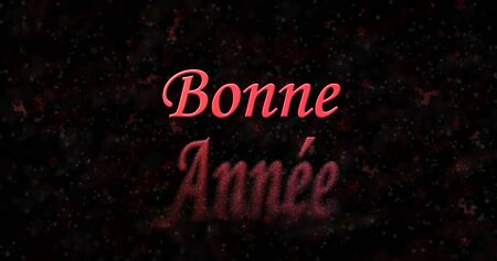 turns of the year: Happy New Year text in French Bonne annee turns to dust from bottom on black background Stock Photo