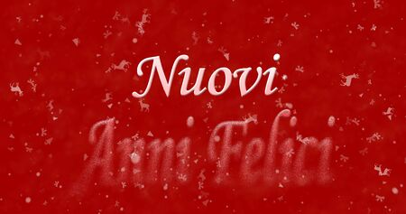 turns of the year: Happy New Year text in Italian Nuovi anni felici turns to dust from bottom on red background
