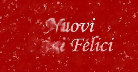 turns of the year: Happy New Year text in Italian Nuovi anni felici turns to dust from left on red background Stock Photo