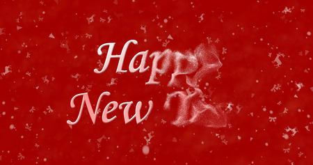 turns of the year: Happy New Year text turns to dust from right on red background Stock Photo