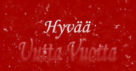 turns of the year: Happy New Year text in Finnish Hyvaa uutta vuotta turns to dust from bottom on red background