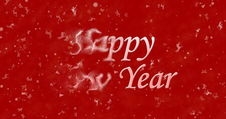 turns of the year: Happy New Year text turns to dust from left on red background