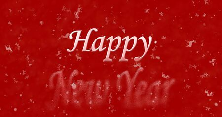 turns of the year: Happy New Year text turns to dust from bottom on red background Stock Photo