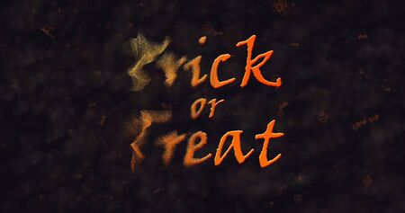 dissolving: Trick or Treat text dissolving into dust to left Stock Photo