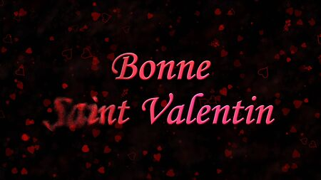 bonne: Happy Valentines Day text in French Bonne Saint Valentin turns to dust horizontally from left on black background with hearts and roses