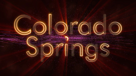 Colorado Springs - United States city name text animation - Shiny rays looping on edge of text over a background with swirling and flowing stars Stock Photo
