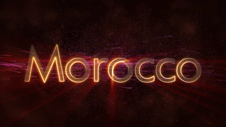 Morocco - Shiny rays on edge of country name text over a  with swirling and flowing stars Фото со стока