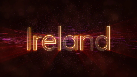 Ireland - Shiny rays on edge of country name text over a background with swirling and flowing stars Фото со стока
