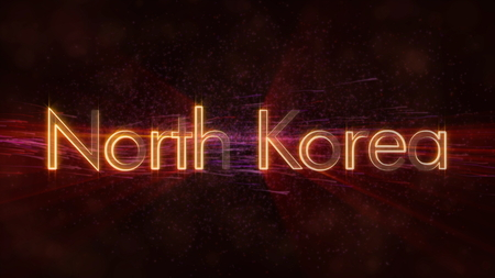 North Korea - Shiny rays on edge of country name text over a background with swirling and flowing stars