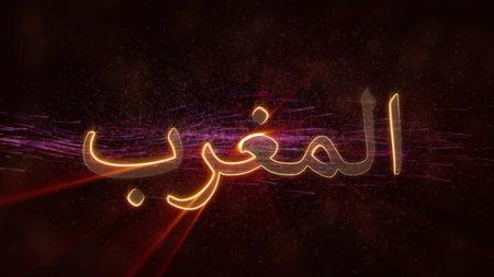 Morocco in local language Arabic - Shiny rays on edge of country name text over a background with swirling and flowing stars
