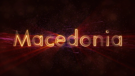 Macedonia - Shiny rays on edge of country name text over a background with swirling and flowing stars Stockfoto