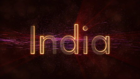 India - Shiny rays on edge of country name text over a background with swirling and flowing stars Фото со стока