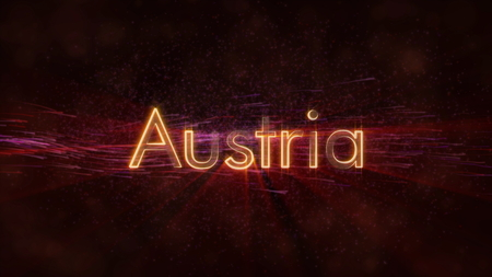 Austria - Shiny rays on edge of country name text over a background with swirling and flowing stars Фото со стока