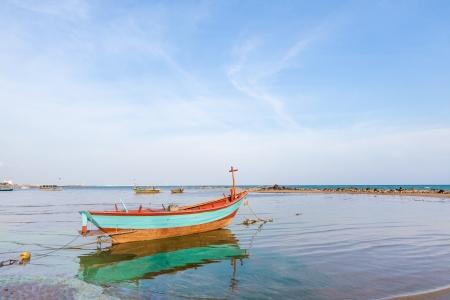 Fishing boat on the muck beach  photo