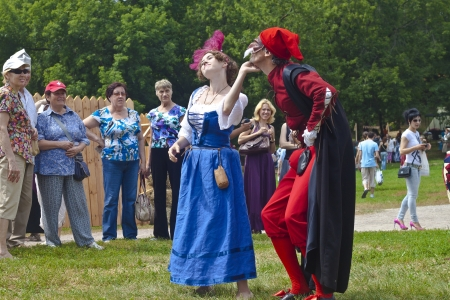 July 7, 2012, Kolomenskoe, Moscow. Festival of the historic reconstruction Times and Epochs. Traditional character of classic italian Comedia dellArte, lustful old Pantalone and maidservant Colombina Stock Photo - 14443703