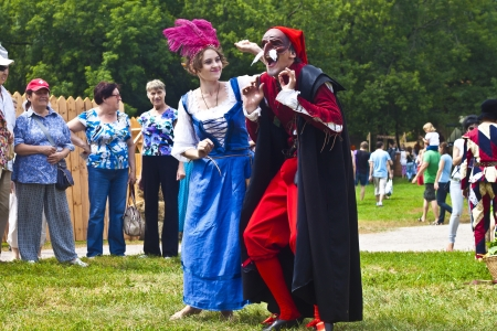 July 7, 2012, Kolomenskoe, Moscow. Festival of the historic reconstruction Times and Epochs. Traditional character of classic italian Comedia dellArte, lustful old  Pantalone and maidservant Colombina Stock Photo - 14443702