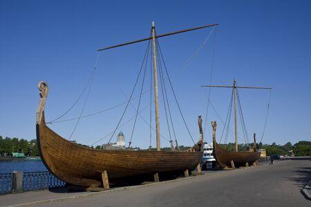 Two ancent viking ships at the Salakka-lahti embankment in Vyborg photo